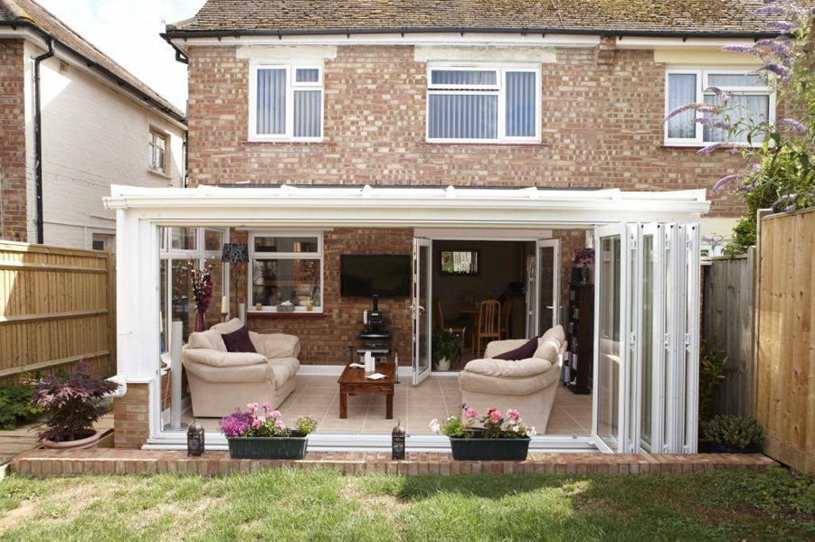 Orangery with bifold doors large orangery with bifold for Conservatory sliding doors